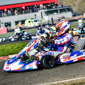 Race action in front of Whilton Mill's clubhouse