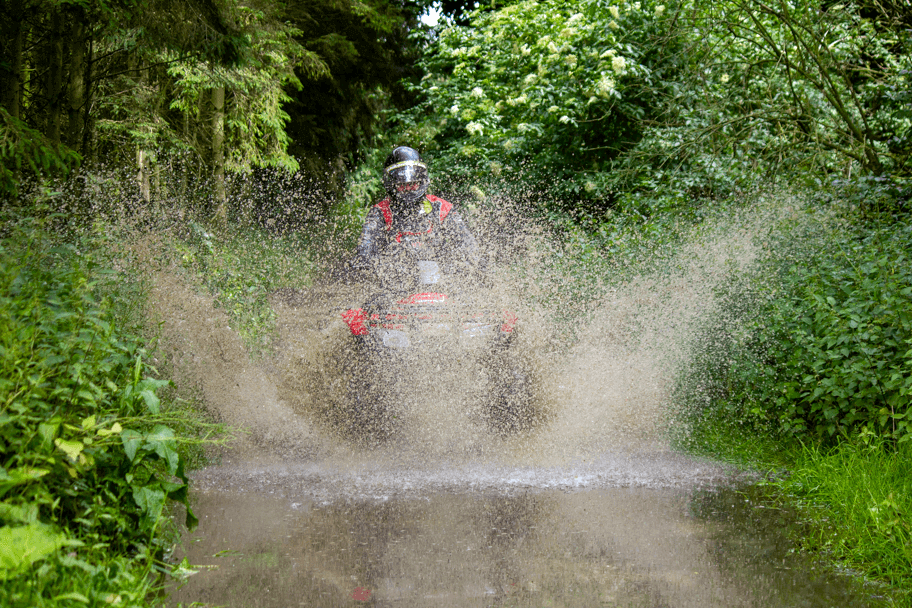 Quad bike splashing through water